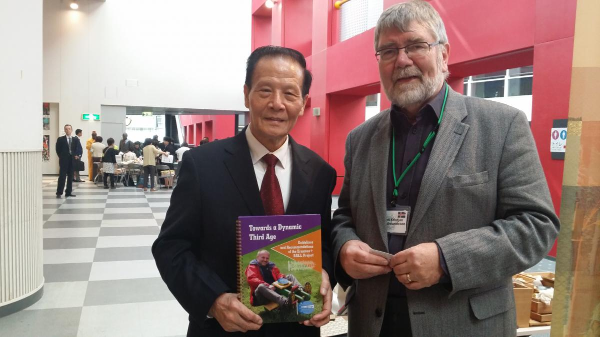 Mr Qicun Yang, president of the Jingdezhen third age university in China receiving a hard copy of the BALL recommendations